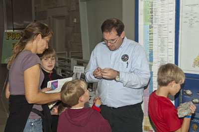 IGS Educational Outreach Coordinator Walter Gray (r) helps some young visitors to identify a rock.