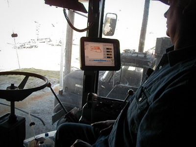 Participating farmer with a yield monitor installed in his combine.