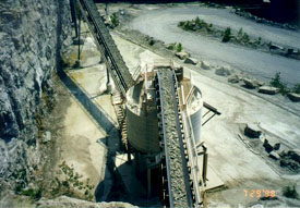 Photo showing crushed stone conveyor.