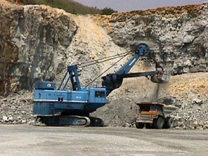 Photo showing electric shovel loading stone.