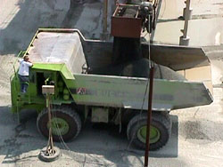 Photo showing crushed stone being loaded into a hauler