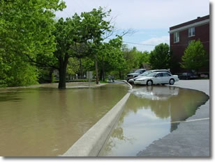 Photo showing flooded parking lot in Franklin, Indiana.